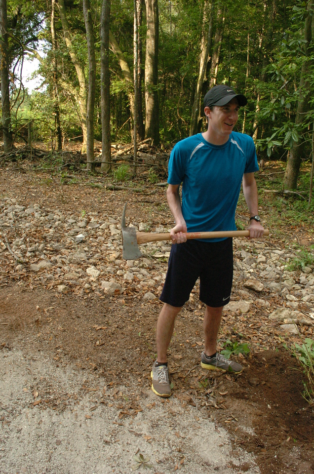 Andy's determined to dig out a sweet gum that was cut off at ground level, and I had the tool for that job.