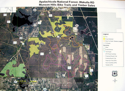 "Here's a late January 07 look at the Munson Hills trail area. Thanks to Jim Schmid for bringing the map! The Forest Service contractor has nearly finished with some area cutting of three categories: 1) ""Thin"" (green area, southwest) 2) ""Group Selection"" (yellow areas, central and north) 3) ""Clear Cut Slash [pine]/Restore Longleaf [pine] (light tan areas, southeast) Trail color keys: Orange solid line = ""Munson Hills"" Purple solid line = Proposed ~11M trail south of Munson Red dash/dot line = ""Twilight"" trail, includes revisions due to clear cuts in Proposed area Yellow dash/dot and Light green dash/dot = ""Paper Cup"" and ""Hare Scramble"" trails  As of 2Feb07, Munson is now officially re-opened to recreation. Much work now lies ahead to clean up, re-route, and build."
