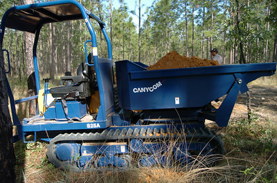 """One of two """"Wolverines"""" being used to transfer base material to trail segments. It's actually a Canycom S25A """"Heavy-duty Carrier with 180° Pivoting Dump Box."""" In other words, it can transfer material exactly where we want it."""