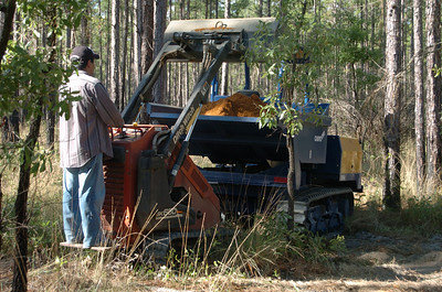 "EZ uses Ditch Witch SK650 to transfer base into ""Wolverine"" for transport to excavated trail segments."