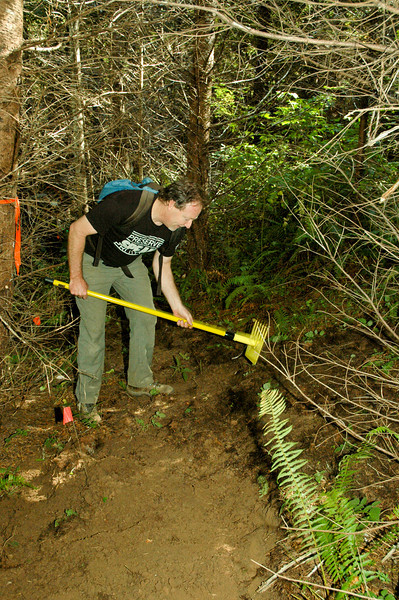 Tom Archer, 2010 president of NWTA digging trail at Stub