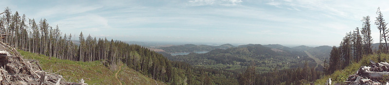 Panorama view of Summit Lake and South Puget Sound in the distance. To the right is the power lines and Rock Candy West. In the bottom left is the Lower North Rim #1 heading into the trees.