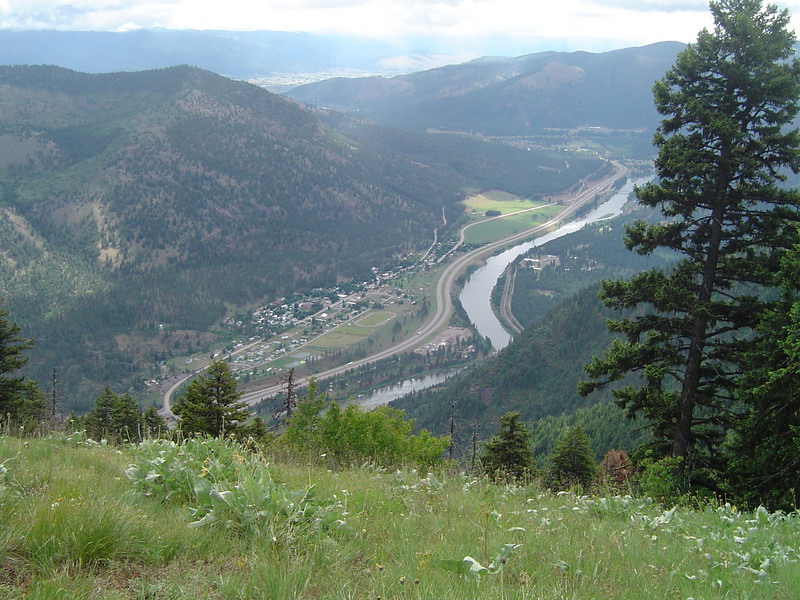 Looking in the opposite direction (East). The town of Alberton directly below. Further in the distance is the Missoula valley.