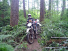 """Riding in the """"Secret Forest"""" I just finished cutting the trees in front of Jon's front wheel. My pocket chainsaw rocks!!"""