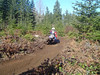 On the Overland trail. Jason going MX style through the berms.