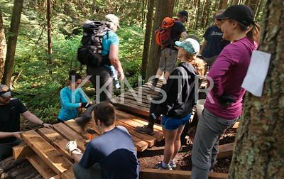 Trail users testing the new boardwalk.