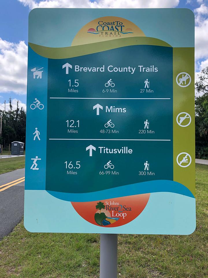 Florida Coast to Coast Trail sign with mileages