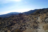 Looking back down the trail.  Sheep and Martinez Mountains in the distance.