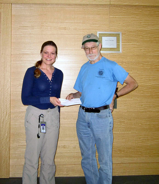 Diane handing the Avon donation to Jakob (picture Diane Dabkowski).