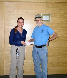 Diane handing the Avon donation to Jakob (picture Diane Dabkowski).