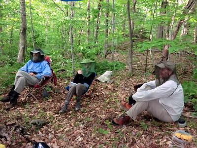 Hiding behind mosquito nets: Paul L., Christine, Paul K.