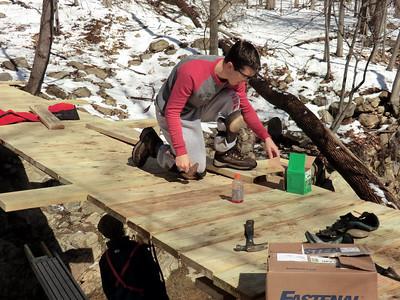 """Johnnie working on """"his"""" bridge."""