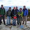 Mike, Jacob, Keith, Andy, Sue, Ryo, posing at the Berrypicker Trail after a job well done. Catskills in the background.