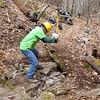 Dave crushing rocks.