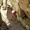 Erik crushing and leveling rock in the crevice (5/5/13).