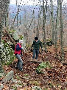 Page and John raking and weeding.