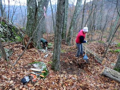 John and Page raking and weeding.