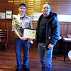 Senior patrol leader Zane Valachovic accepts award from Andy Garrison.