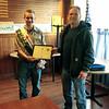 Senior patrol leader Zane Valachovic accepts award from Andy Garrison.