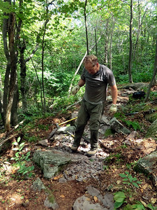 Andy working on the small relo below the steps - crushing lots of rocks (8/25/13).