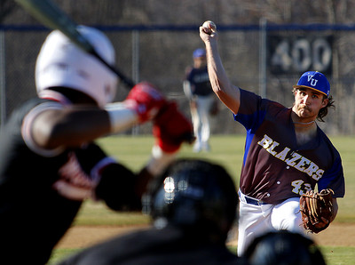 Photo by Matt Griffith/VU  Vincennes University's Mitch Behrie fires a pitch to Wabash Valley's Hylan Hall  Wednesday at Blemker Field.