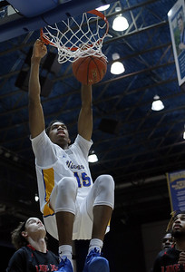 Photo by Matt Griffith /VU   Vincennes University's John Ukomadu slams home the ball against the Lake Land defese Wednesday night in the P.E. Complex.