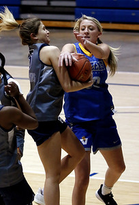 Photo by Matt Griffith  Vincennes University's Macy Michels, right, and Olney Central's Macy Robbins, try to control a rebound Wednesday during a scrimmage in the P.E. Complex.