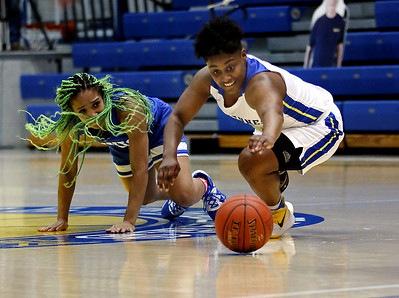 Photo by Matt Griffith/VU  Vincennes Univeristy's Shaila Beeler, right, leaps to control a loose ball away from Southwestern Illinois' Jayla Fox, Tuesday in the P.E. Complex.