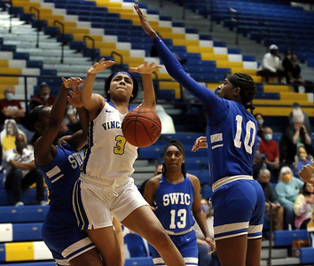 Photo by Matt Griffith/VU  Vincennes University's Alexis Radcliff, 3, draws a foul as Southwestern Illinois' Destiny Roberson, 10 defends Tuesday night in the P.E. Complex.
