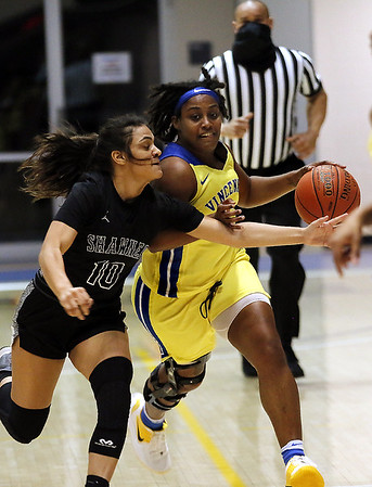 Photo by Matt Griffith /VU   Vincennes University's Shaila Beeler, right,  hussels upcourt against the defense of Shawnee's 10, Monday night in the P.E. Complex.