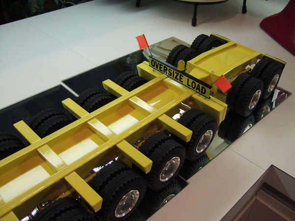 The Booster is a 2-axle unit with tail light bezels and reflectors.  The tires and wheels match the rear-axle unit.