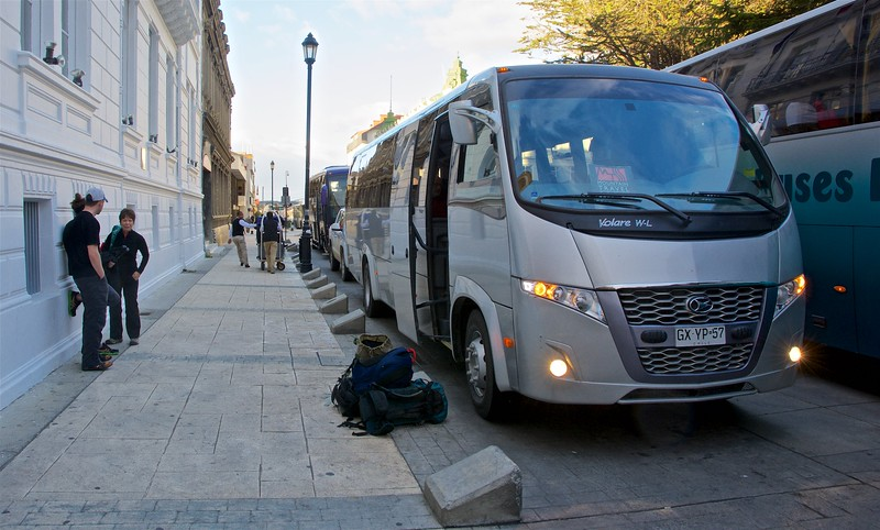 Our bus to Torres del Paine loading up. Against the wall, James and Rebecca are chatting with Laurie