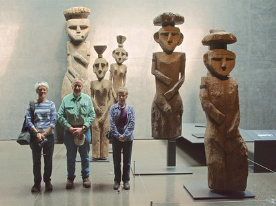 Sue, Roger and Susie, among some large wooden statues in the museum