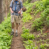 Doug hiking through the lush woods