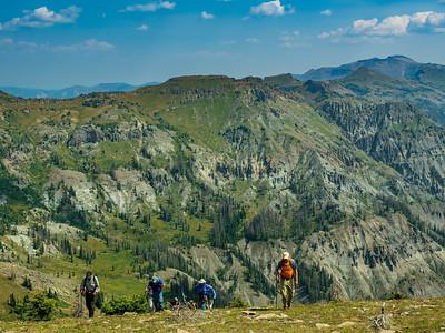 Onward and upward, hiking up the grassy slopes of Blackhead.