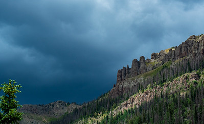 """The clouds are beginning to look a little wicked above the """"Old Man of the Mountain"""" as we wait for our shuttle"""