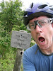 A silly backcountry sign. Mount Roger NRA has extensive multi-use trail systems, making it a great place for backcountry mountainbiking. This sign is at the top of a series of switchbacks that drop down a few countour lines at a large upland bowl. The trail is rough and going 15 mph here is probably impossible.