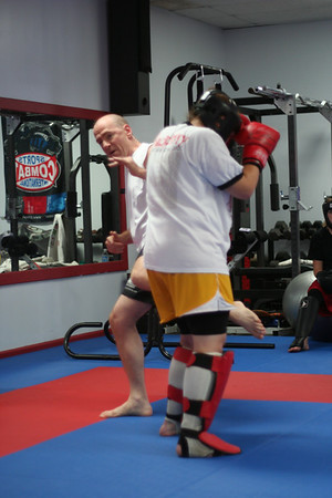 Mr. Dring showing Leg Kicks on Natalie.