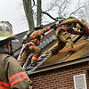 KRISTOPHER RADDER — BRATTLEBORO REFORMER<br /> On his first day on the job, Brody Burke, a Brattleboro firefighter, cuts a hole into a roof as firefighter Will Streeter supports him while Capt. Charles Keir watches during a ventilation training at Melrose Terrace on Monday, Oct. 28, 2019.