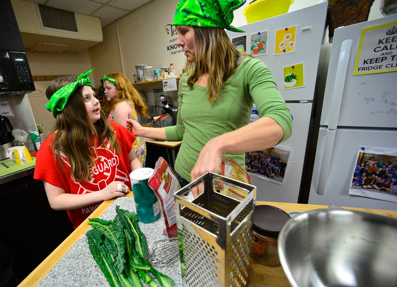 KRISTOPHER RADDER — BRATTLEBORO REFORMER<br /> Phoenyx Gervais, a fifth-grader at Green Street School, talks with Tara Gordon, about what they will be preparing as they train for the Junior Iron Chef state competition on Wednesday, Feb. 27, 2020.
