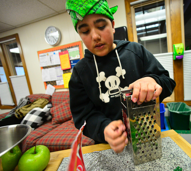 KRISTOPHER RADDER — BRATTLEBORO REFORMER<br /> Jeriah Easton, a sixth-grader at Green Street School, uses a grater on a beet that will be used as a dye in their recipe as they train for the Junior Iron Chef state competition on Wednesday, Feb. 27, 2020.