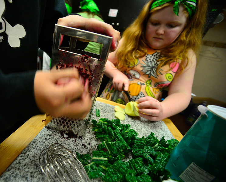 KRISTOPHER RADDER — BRATTLEBORO REFORMER<br /> Alex Aither, a fifth-grader at Green Street School, cuts up potatoes as sixth-grader Jeriah Easton uses a grater on a beet that will be used as a dye in their recipe as they train for the Junior Iron Chef state competition on Wednesday, Feb. 27, 2020.