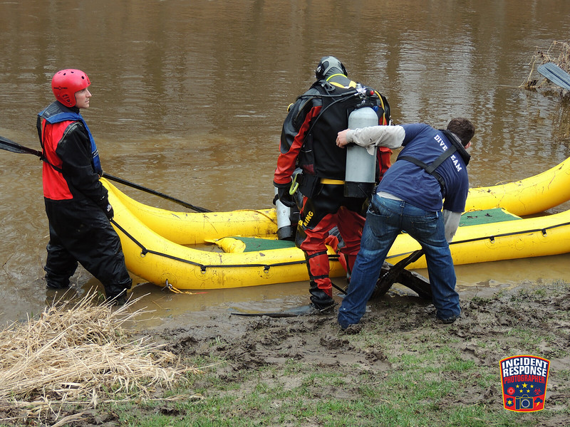The Sheboygan County Dive Team held a swift water rescue drill in Sheboygan Falls, Wisconsin on Monday, April 21, 2014. Photo by Asher Heimermann/Incident Response.