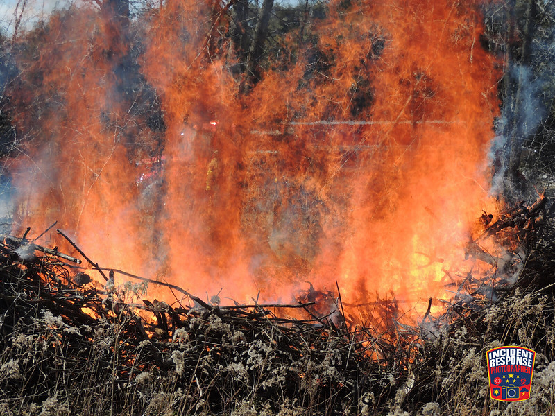 The Town of Wilson Fire Department conduct a controlled burn on South 12th Street in Sheboygan, Wisconsin on Saturday, April 5, 2014. Photo by Asher Heimermann/Incident Response.