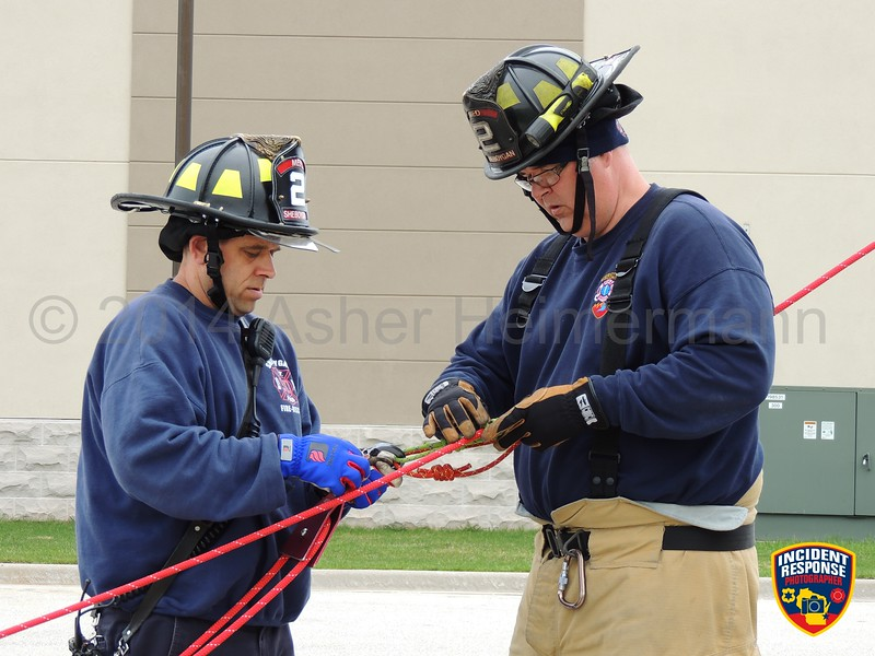Sheboygan firefighters practice rope rescue techniques in the South Pier District in Sheboygan, Wisconsin on Wednesday, May 14, 2014. Photo by Asher Heimermann/Incident Response.
