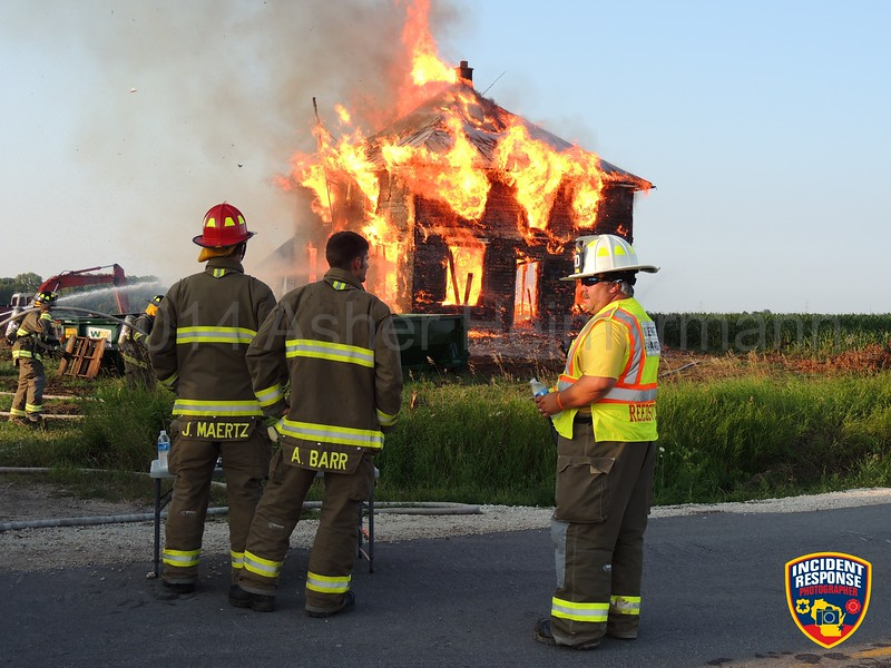 The Reedsville Fire Department conducted a live house burn in Reedsville, Wisconsin on Wednesday, August 6, 2014. Photo by Asher Heimermann/Incident Response.