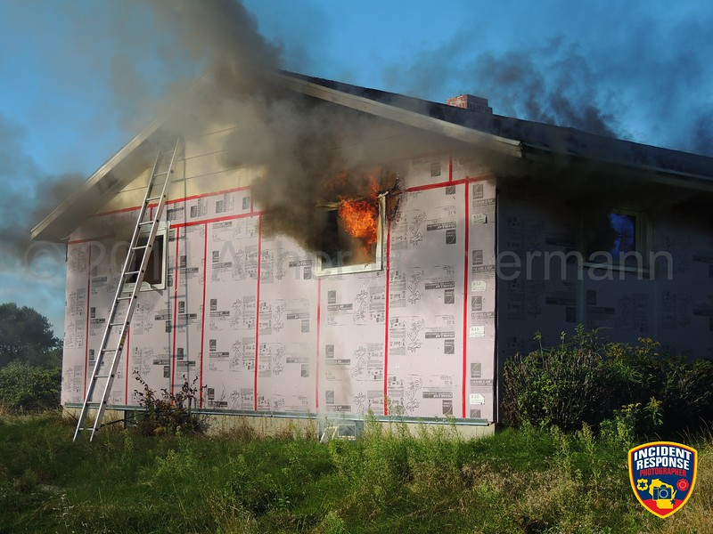 The Town of Wilson Fire Department conducted a live house burn on Black River Road in Sheboygan, Wisconsin on Saturday, September 6, 2014. Photo by Asher Heimermann/Incident Response.