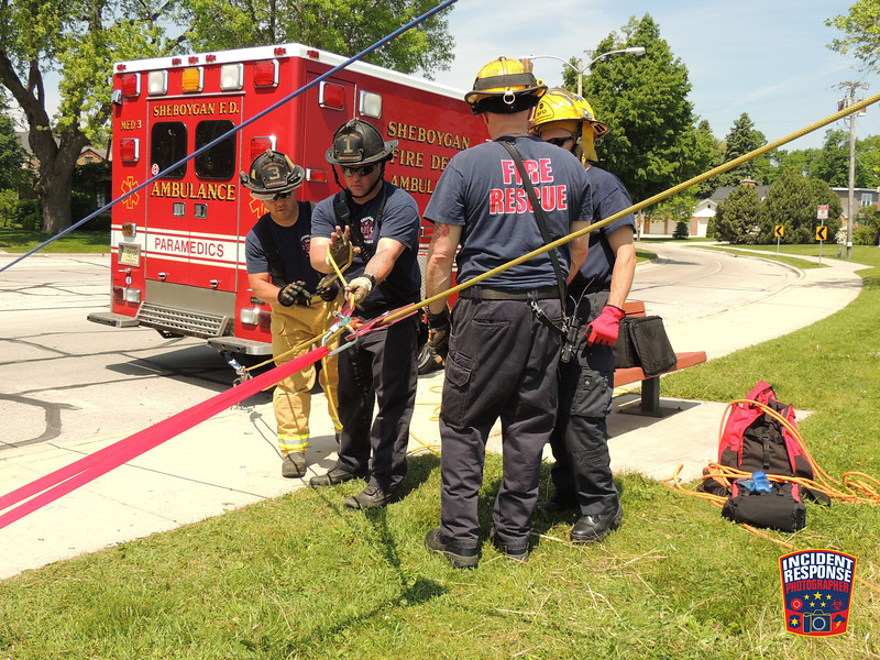 Sheboygan firefighters practice for bluff rescues on North 3rd Street in Sheboygan, Wisconsin on Wednesday, June 10, 2015. Photo by Asher Heimermann/Incident Response.