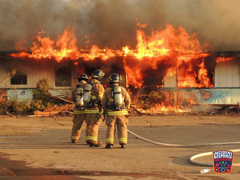 Firefighters from Town of Wilson, Oostburg, Cedar Grove, Haven, Kohler, City of Sheboygan Falls and Town of Sheboygan Falls fire departments participated in a burn down of a vacant motel at 3901 Motel Road in the Town of Wilson, Wisconsin on Monday, June 8, 2015. Photo by Asher Heimermann/Incident Response.