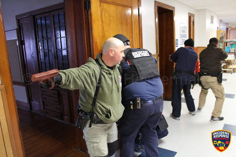 Officers from the Sheboygan Police Department and firefighter paramedics from the Sheboygan Fire Department trained for active shooter situations at the former Washington Elementary School on Wednesday, January 20, 2016. Photo by Asher Heimermann/Incident Response.